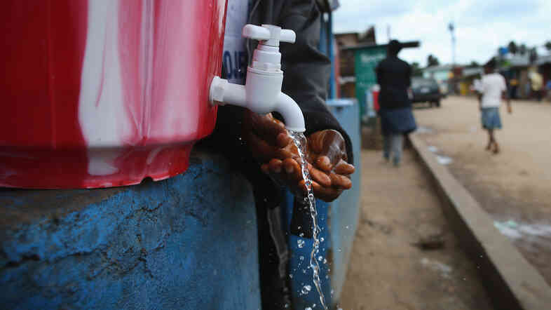 On the streets of Liberia, chlorinated water is available for hand washing.