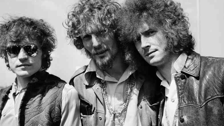 "Jack Bruce, left, seen here with fellow Cream members Ginger Baker (center) and Eric Clapton in 1967, has died. The bassist sang such hits as ""Sunshine of Your Love."""