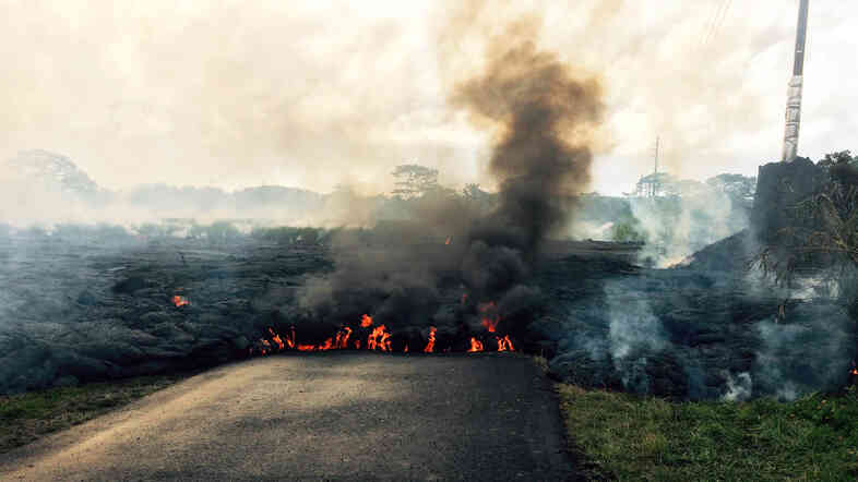 The lava flow from Kilauea Volcano crossed Apa'a Street near Cemetery Road, near the town of Pahoa on the Big Island of Hawaii, on Friday. The flow began June 27; residents in the flow path have now been told to prepare for a possible evacuation.