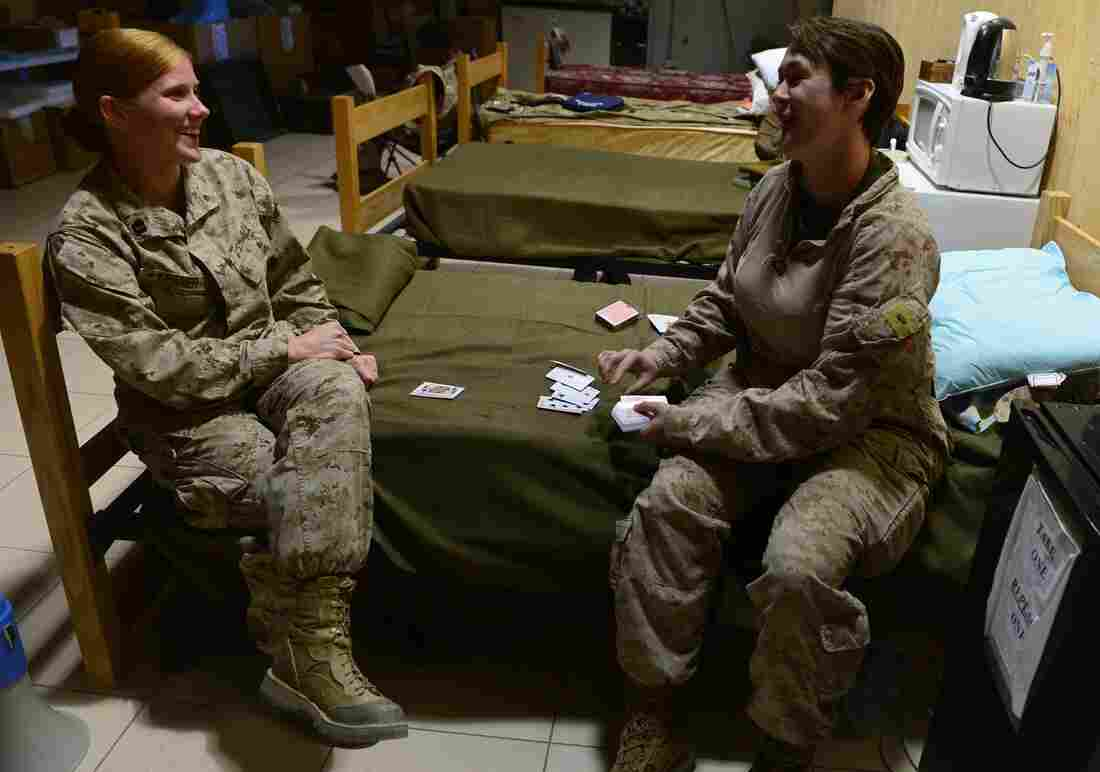 Marines play a game of cards as British and U.S. troops prepare to leave the Camp Bastion-Leatherneck complex at Lashkar Gah in Afghanistan's Helmand province. The base was formally handed over to an Afghan force Sunday.