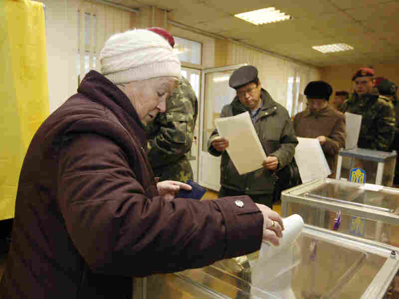 People cast their ballots at a polling station during Ukrainian parliamentary elections in Kiev on Sunday.