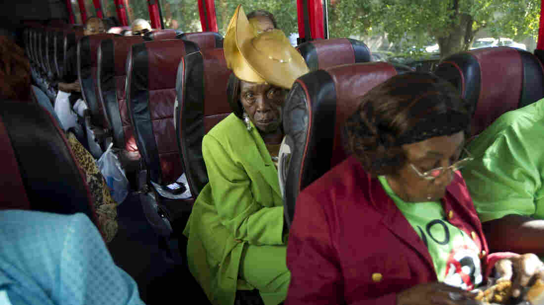 """Martha Frazier rides a bus to vote in Miami in 2012. This year, Georgia churches are running similar """"Souls to the Polls"""" programs, busing worshipers to early voting locations after Sunday service."""