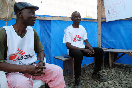 Counselors James Timothy Nah (right) and Prophet Muhammed Sano try to ease the stresses of Ebola patients and their family members.