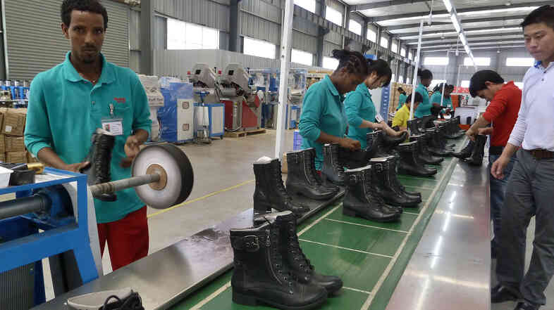 People working on the assembly line in April 2012 at Huajian shoe factory in Dukem, Ethiopia.