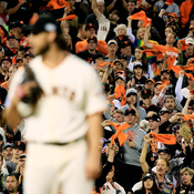 Fans cheer during the 2014 World Series between the San Francisco Giants and the Kansas City Royals at AT&T Park.