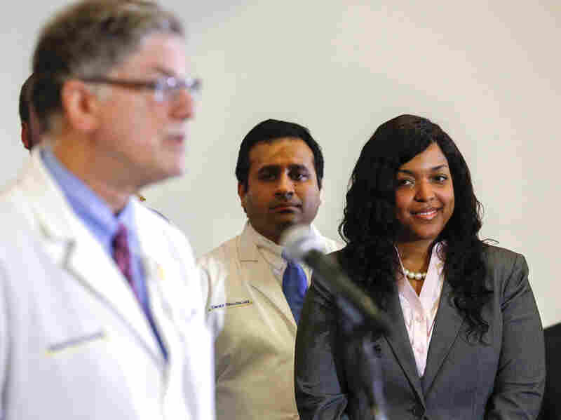 Ebola virus survivor Amber Vinson (Right) listens to Doctor Bruce Ribner, medical director of the Serious Communicable Disease Unit at Emory University Hospital during a press conference in Atlanta, on October 28, 2014. Vinson was one of two nurses who contracted Ebola while treating Liberian citizen Thomas Eric Duncan at Texas Health Presbyterian in Dallas, Texas.