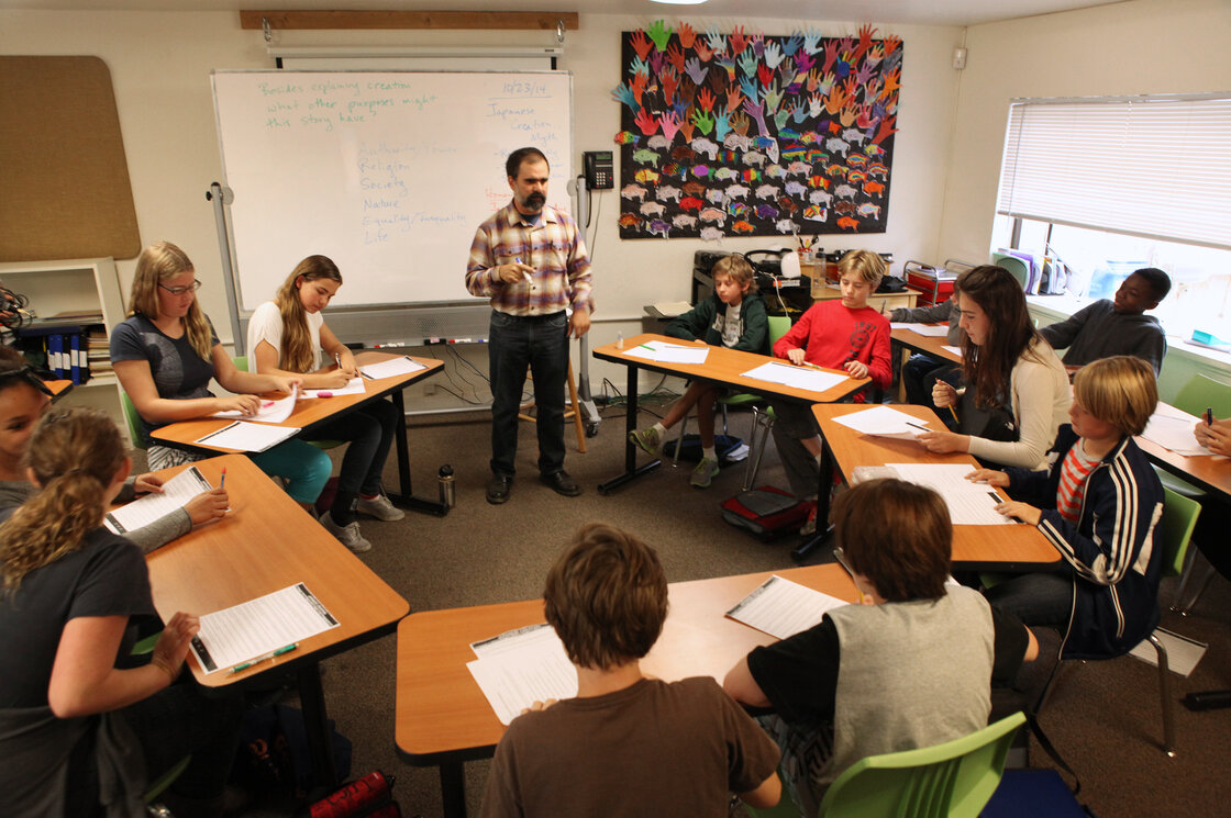 Seventh-grade students respond to teacher Tim Ogburn's questions about a Japanese creation myth. Their school, Black Pine Circle, in Berkeley, Calif., follows the Socratic method.