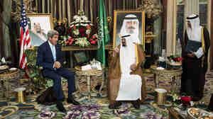 U.S. Secretary of State John Kerry speaks with Saudi King Abdullah bin Abdul Aziz al-Saud as the Saudi ambassador to the United States, Adel al-J