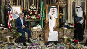 U.S. Secretary of State John Kerry speaks with Saudi King Abdullah bin Abdul Aziz al-Saud as the Saudi ambassador to the United States, Adel al-Jubeir, listens before a meeting at the Royal Palace in Jiddah, Saudi Arabia, on Sept. 11.