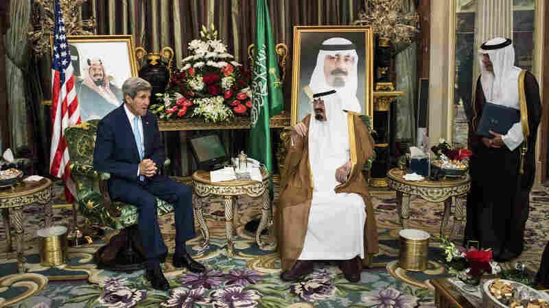 U.S. Secretary of State John Kerry speaks with Saudi King Abdullah bin Abdul Aziz al-Saud as the Saudi ambassador to the United States, Adel al-Jubeir, listens before a meeting at the Royal Palace in Jiddah, Saudi Arabia, on Sept. 11.