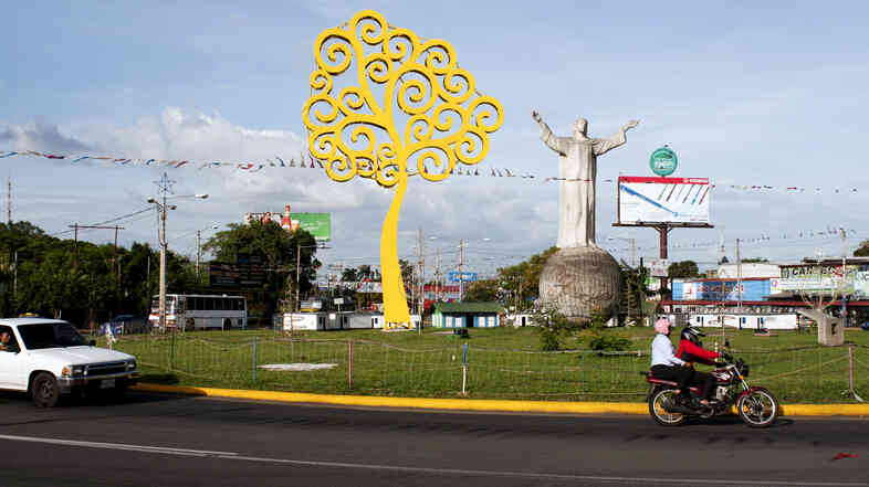 """A statue of Jesus Christ called """"Cristo Rey"""" is prominently located near the entrance of the Dimitrov neighborhood, which used to be so violent, people joked the Christ was being held up at gunpoint."""