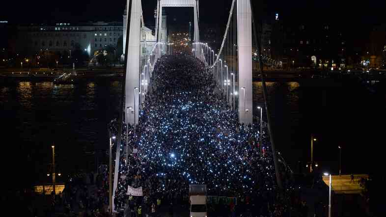 Thousands participants march accross the Elisabeth bridge during an anti-government rally against the government's plan to tax Internet usage.
