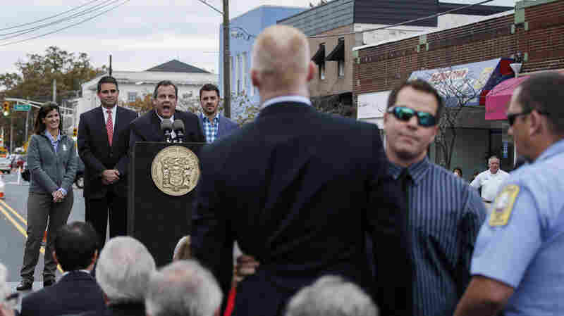A man is removed by security guards while he shots slogans to New Jersey Governor Chris Christie during a public event in Belmar, N.J.