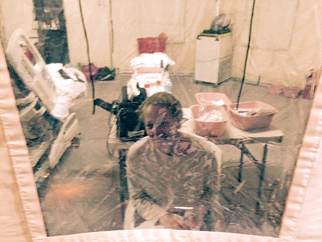 A photo taken Sunday of Kaci Hickox in an isolation tent at University Hospital in Newark, N.J. Hickox who was later discharged and allowed to return to her home in Maine says she has no intention of abiding by a