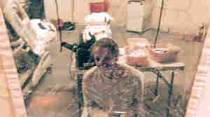 "A photo taken Sunday of Kaci Hickox in an isolation tent at University Hospital in Newark, N.J. Hickox, who was later discharged and allowed to return to her home in Maine, says she has no intention of abiding by a ""voluntary"" quarantine there."