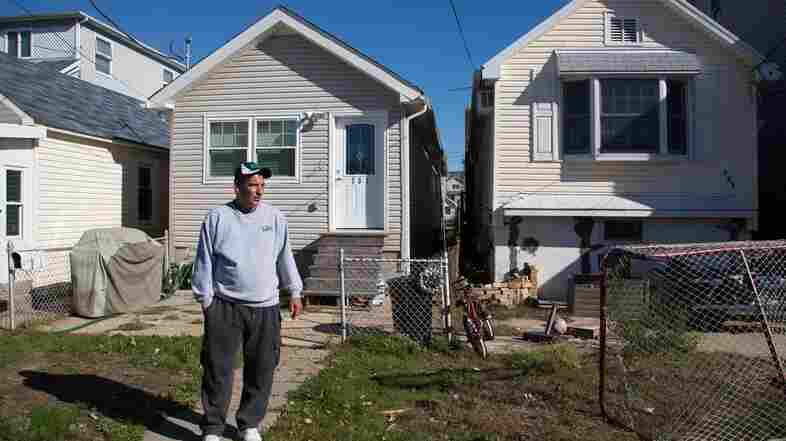 Stephen Drimalas stands outside his former home in Staten Island's Ocean Breeze neighborhood. He rebuilt his home after Hurricane Sandy but recently decided to sell it to the state.