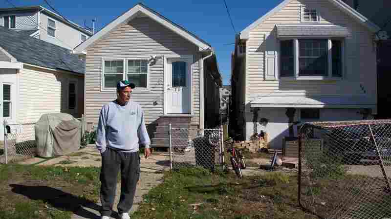 Stephen Drimalas stands outside his former home in Staten Island's Ocean Breeze neighborhood. He rebuilt his home after Superstorm Sandy but recently decided to sell it to the state of New York.