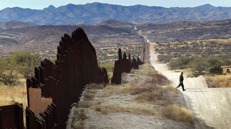 U.S. Border Patrol agent Richard Funke looks for footprints from illegal immigrants crossing the U.S.- Mexico border near Nogales, Ariz., in 2010.