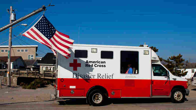 In the aftermath of Superstorm Sandy, a former Red Cross official says as many as 40 percent of the organization's emergency vehicles were assigned for public relations purposes. This photo, which shows one of their trucks in Long Island, N.Y., in January 2013, is one example of the many publicity photos taken by the Red Cross.