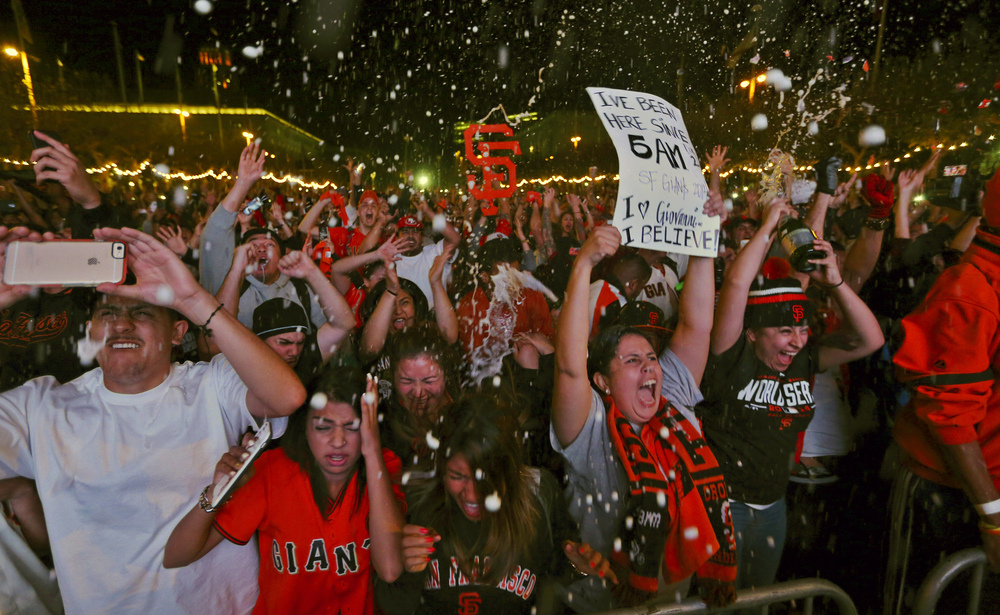 Fans celebrate the Giants' victory during a television-viewing event at the Civic Center in San Francisco.