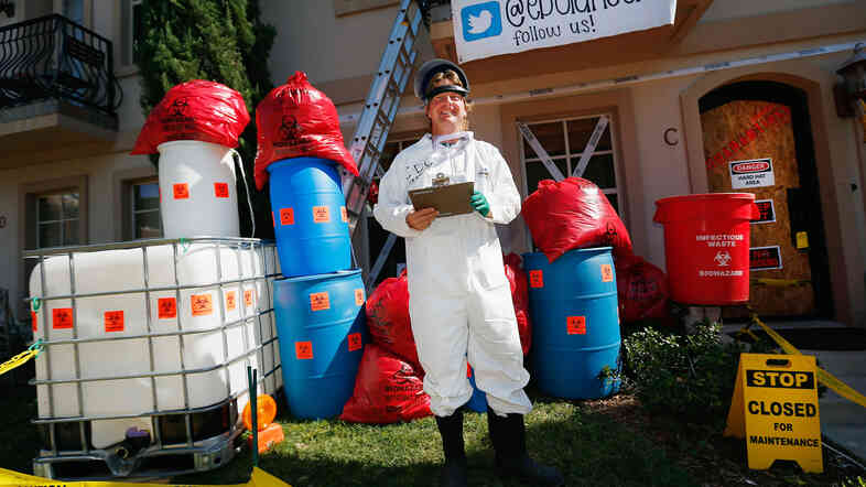 Dallas-area resident James Faulk turned his yard into an Ebola treatment center for Halloween. But he has a serious side: his Twitter account raises funds for Doctors Without Borders, a group active in the fight against the virus.