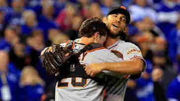 Buster Posey (left) and Madison Bumgarner of the San Francisco Giants celebrate after defeating the Kansas City Royals in the World Series on Wednesday in Kansas City, Mo.