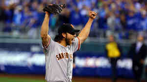 Madison Bumgarner of the San Francisco Giants celebrates after defeating the Kansas City Royals to win game seven of the 2014 World Series.