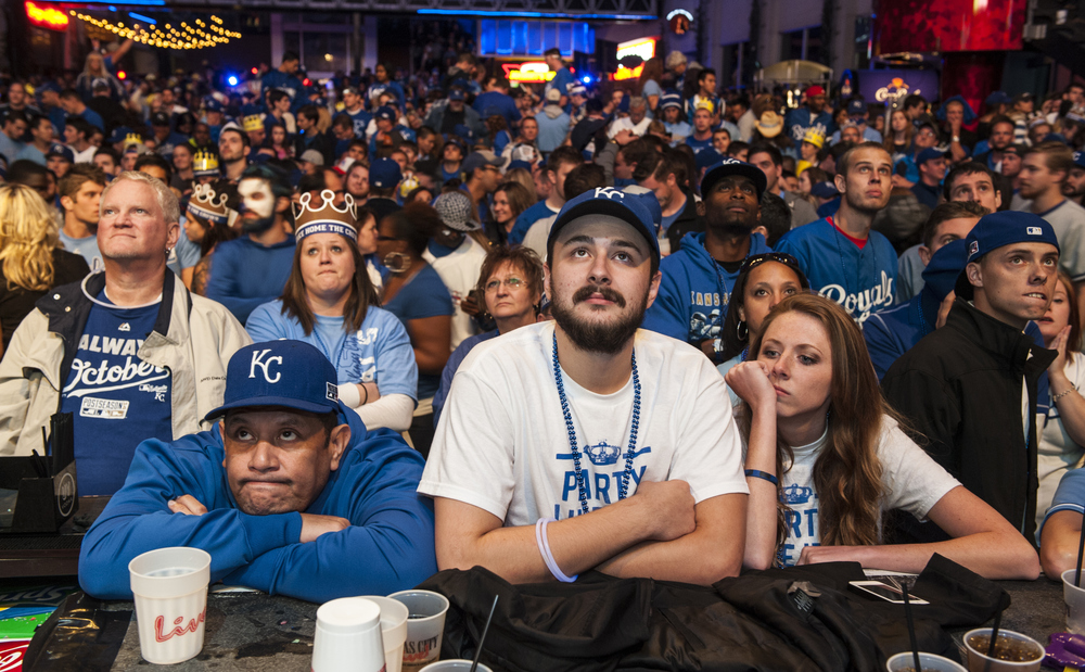 Royals fans watch their team's defeat in the Power and Light District during Game 7 of the World Series on Wednesday in Kansas City, Mo.