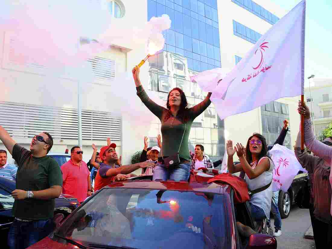 Supporters of the secular Nidda Tounes (Tunisia Calls) party celebrate their victory in parliamentary elections before the elections were official earlier this week in Tunis.
