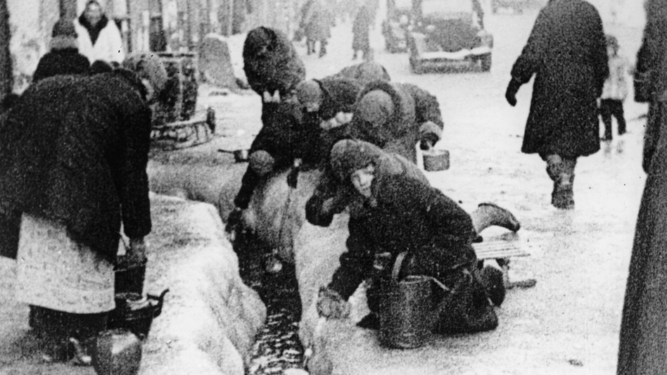Citizens of Leningrad collect water from a broken main in the winter of 1942, during a blockade of the Russian city by Nazis. (AP)
