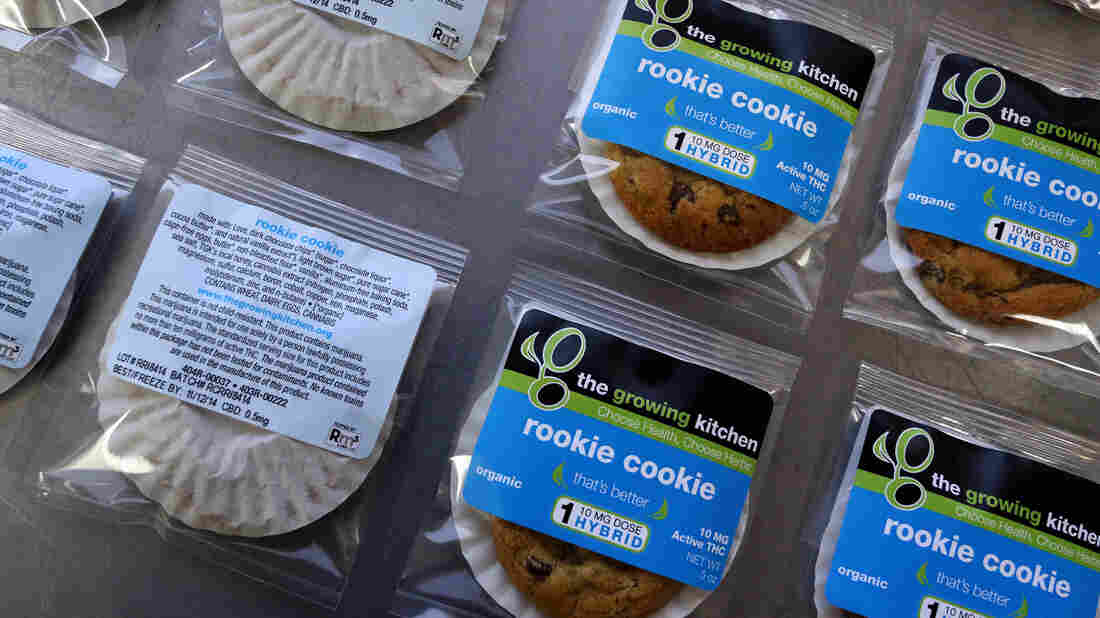 Low-dose pot-infused cookies, called the Rookie Cookie, sit on the packaging table Sept. 26 at The Growing Kitchen in Boulder, Colo. The state legalized recreational pot use last year.