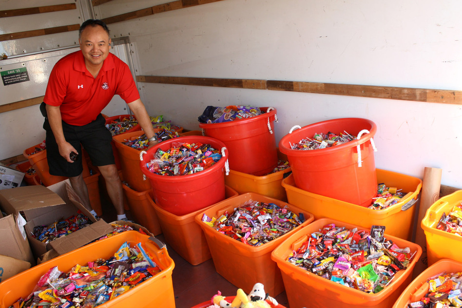 Dr. Curtis Chan, a dentist in Del Mar, Calif., loads up a truck with 5,456 pounds of candy to deliver to Operation Gratitude during the Halloween Candy Buyback on Nov. 8 last year. Chan personally collected 3,542 pounds of candy from patients. (Courtesy of Curtis Chan)