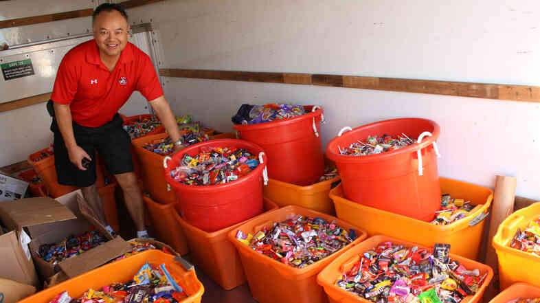 Dr. Curtis Chan, a dentist in Del Mar, Calif., loads up a truck with 5,456 pounds of candy to deliver to Operation Gratitude during the Halloween Candy Buyback on Nov. 8 last year. Chan personally collected 3,542 pounds of candy from patients.