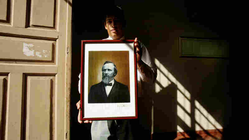 Paraguayan government employee Daniel Alonso holds a portrait of Rutherford B. Hayes at the government building in Villa Hayes, the Paraguayan town named after the 19th U.S. president. Hayes is revered for a decision that gave the country 60 percent of its present territory.