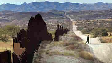 U.S. Border Patrol agent Richard Funke looks for footprints from illegal immigrants crossing the U.S.- Mexico border on Dec. 7, 2010, near Nogales, Ariz.