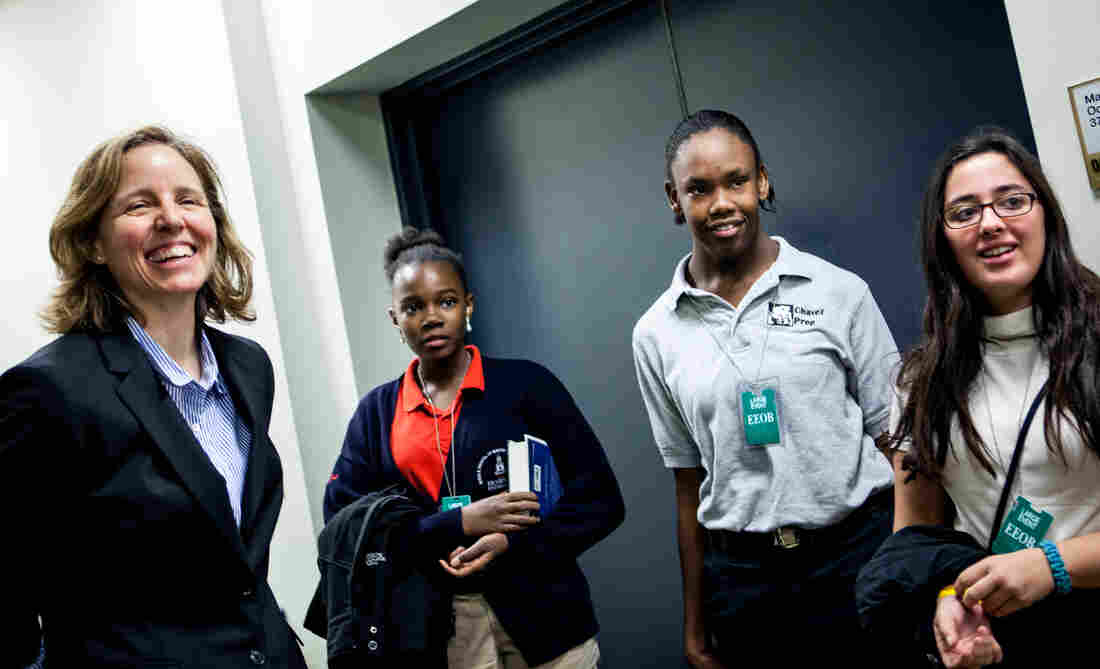 Megan Smith, left, meets with middle school students Mikaelle, from Howard University Middle School; Shayna, from Chavez Prep; and Hannah, from School Without Walls after her presentation.