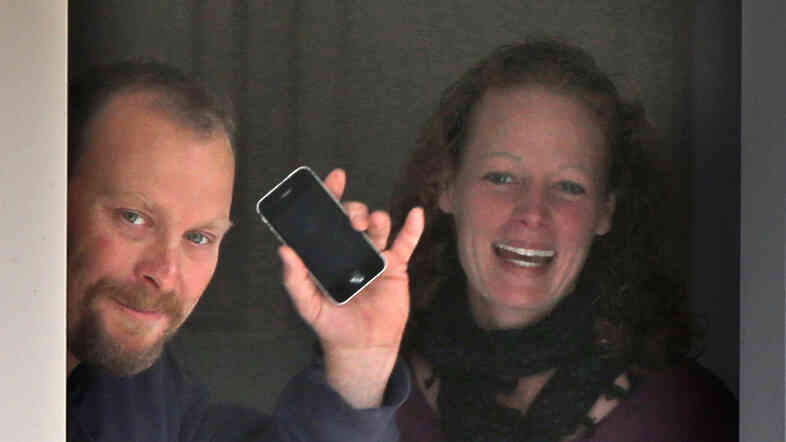 Nurse Kaci Hickox and her boyfriend, Ted Wilbur, take delivery of a pizza at their home in Fort Kent, Maine, on Thursday. A judge has ruled that the state cannot compel Hickox to re