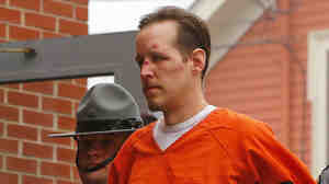 Eric Frein is escorted by police into the Pike County Courthouse for his arraignment in Milford, Pa., on Friday. Frein was captured by police on Thursday after a seven-week manhunt.