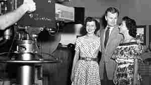 Betty White (left) stands alongside actor Eddie Albert in front of the a KLAC-TV camera during a broadcast of the live talk show, 'Hollywood on Television,' in 1