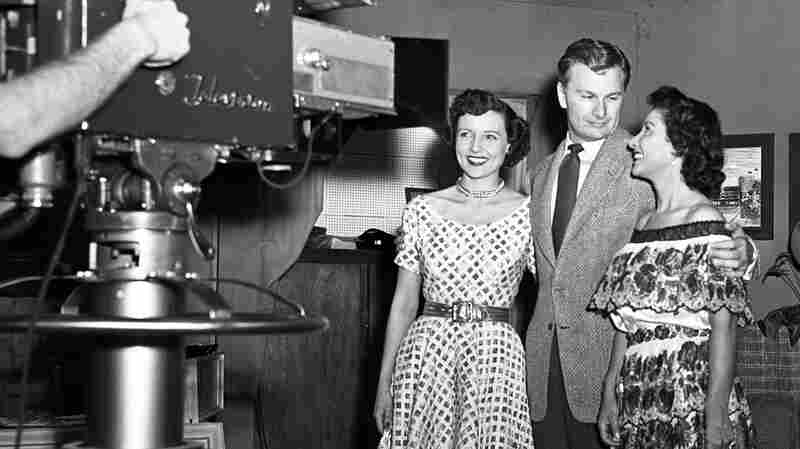 Betty White (left) stands alongside actor Eddie Albert in front of the a KLAC-TV camera during a broadcast of the live talk show, 'Hollywood on Television,' in 1952.