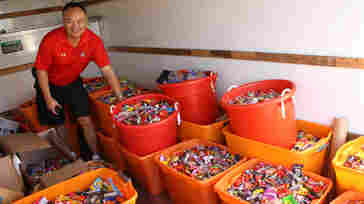 Dr. Curtis Chan, a dentist in Del Mar, Calif., loads up a truck with 5,456 pounds of candy t