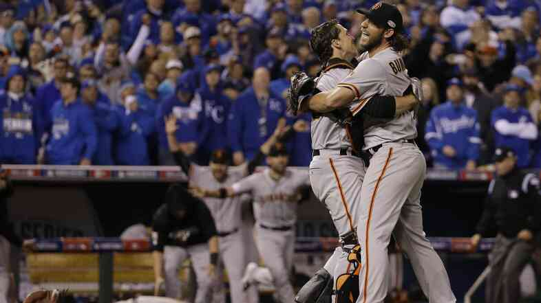 Madison Bumgarner and catcher Buster Posey of the San Francisco Giants celebrate after winning Game 7 of baseball's World Series against the Kansas City Royals.