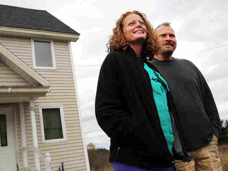 Kaci Hickox stands with her boyfriend Theodore Michael Wilbur as she gives a statement to the media in front of her home on Oct. 31, 2014 in Fort Kent, Maine.
