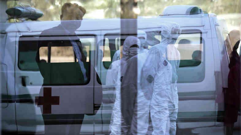 North Korean medical workers wore protective suits at Pyongyang's Sunan International Airport this week.