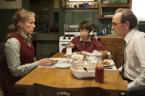 The story of Olive and her family is told mostly in a series of flashbacks. Above, Olive (McDormand), her husband, Henry (Richard Jenkins), and their son, Christopher (Devin McKenzie), have a tense moment at the dinner table.