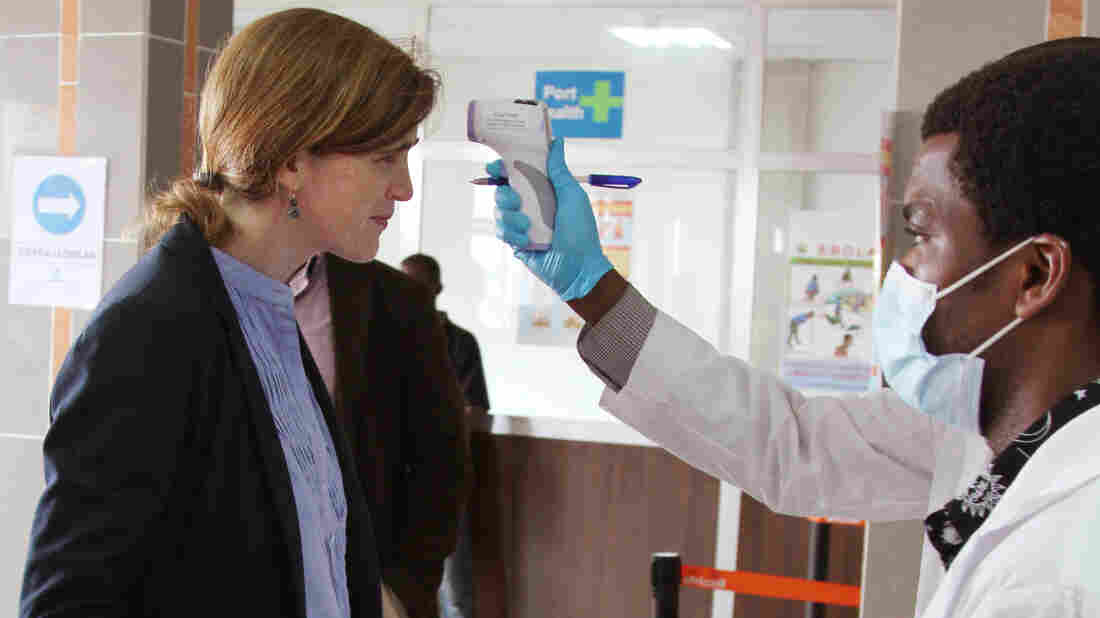 U.S. Ambassador to the United Nations Samantha Power had her temperature taken as she arrived in Freetown, Sierra Leone.