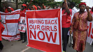 """People call for the Nigerian government to rescue girls taken from a secondary school in Chibok region, during a protest earlier this month. Boko Haram, the group that took the girls, says they have been """"married off."""""""