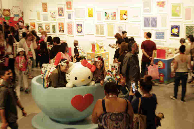 Attendees take pictures at Hello Kitty Con at the Geffen Contemporary at MOCA in Los Angeles Friday. Some 25,000 fans are expected to attend Hello Kitty Con between Oct. 30 and Nov. 2.