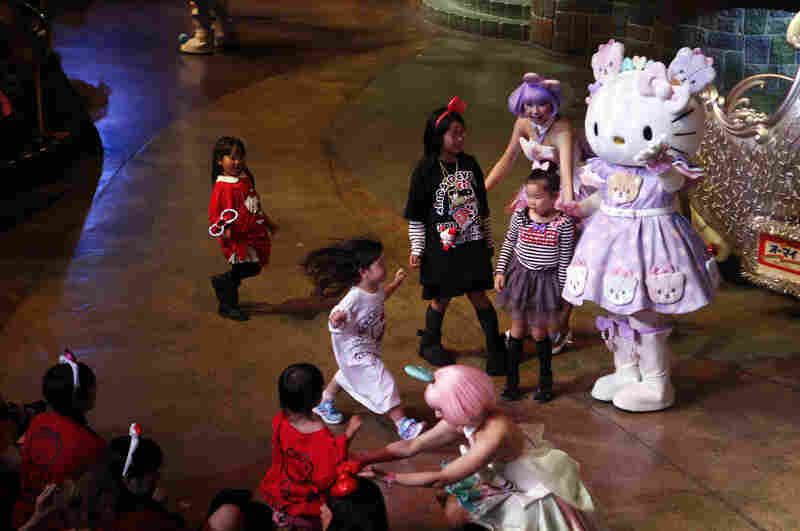 Children from the audience come on stage to dance with Hello Kitty and celebrate her 40th birthday at Sanrio Puroland theme park in Tokyo Saturday.