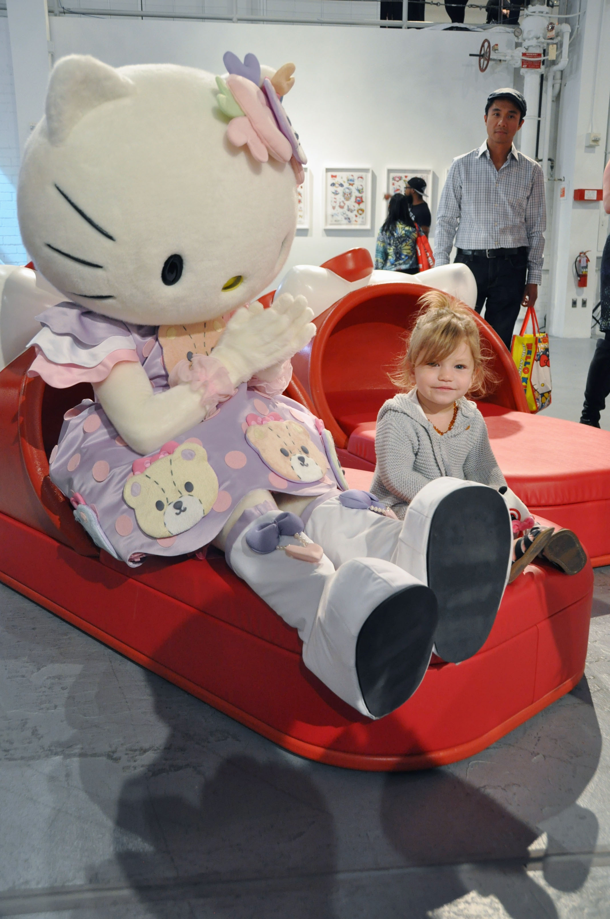 sits by Hello Kitty at the Museum of Contemporary Art in Los Angeles ...